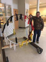 TC Alumni helps build dream catcher at TCES